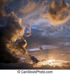 Fresh Morning Clouds with Sun - Blue sky with yellow backlit...