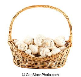 Fresh mushrooms in a wicker basket