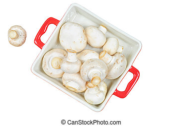Fresh mushrooms in red tray isolated