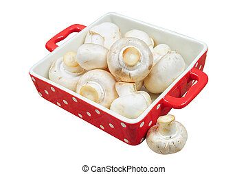 Fresh mushrooms in red tray, isolated