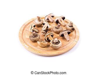 Fresh mushrooms on a chopping board