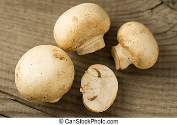 fresh mushrooms on wooden background, close-up