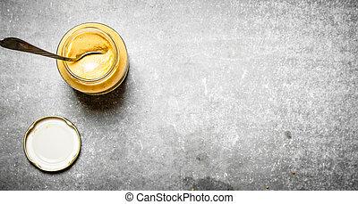 Fresh mustard in a jar