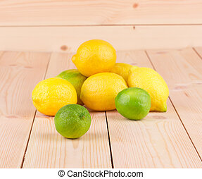 Fresh natural lemons on the wooden background.