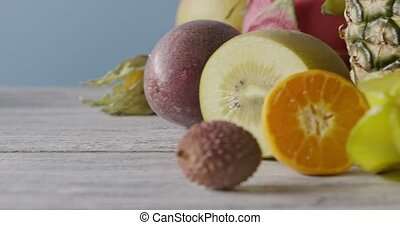 Fresh natural organic exotic fruits on a wooden gray...