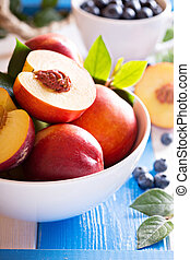 Fresh nectarines in a bowl