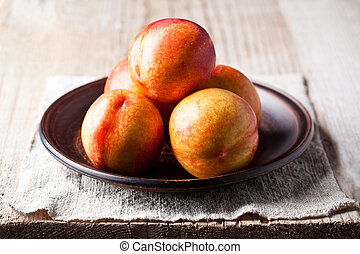 fresh nectarines in a plate