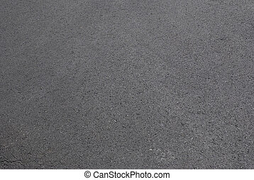 freshly laid black tar asphalt pavement - a new sidewalk surface made of bitumen.