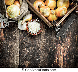 Fresh onion in a box and bag.