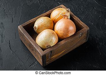 Fresh onions harvest, on black background