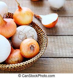 fresh onions in a basket