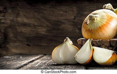 Fresh onions in a basket.