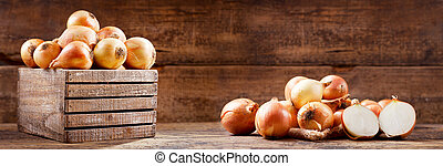 fresh onions in a wooden box