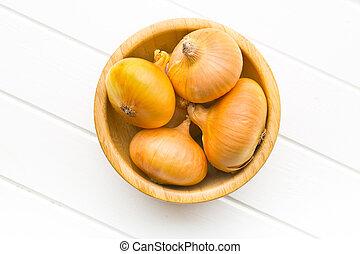 fresh onions in bowl