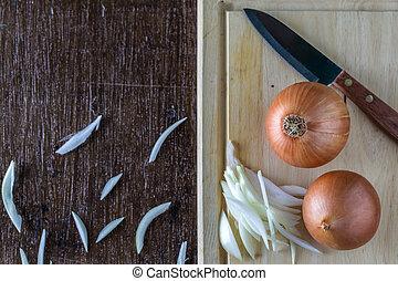 Fresh onions on a cutting board