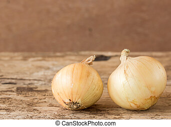 Fresh onions vegetables on wooden table