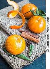 Fresh orange and leaf on hemp sack.