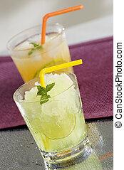 drink - fresh orange and lemon ice drinks close up