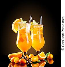 Fresh orange cocktails on black background