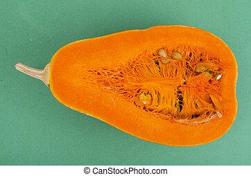 Fresh orange cut in half Cucurbita moschata.