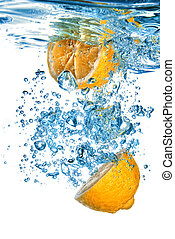 Fresh orange dropped into water with bubbles isolated on white