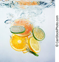 Fresh orange dropped into water with splash isolated on ...