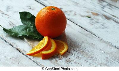 Fresh Orange freshly picked on stylish rustic table, 4k dolly shot