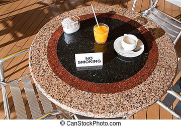 fresh orange juice and cappuccino on no smoking table