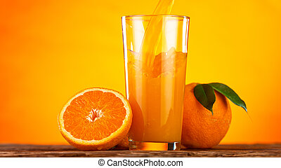 Fresh Orange Juice Being Poured into a Glass.