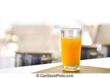 Fresh orange juice in a glass on the table
