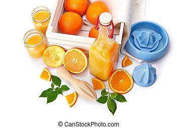 Fresh orange juice with fruit and green