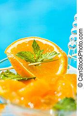 Fresh orange Mojito cocktail  with twist