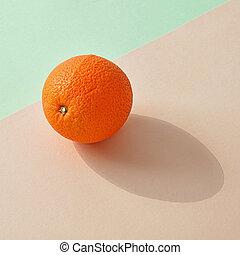 fresh orange on colorful background