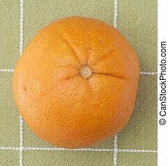 Fresh Orange on Green Background