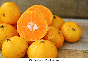 Fresh orange on wooden table