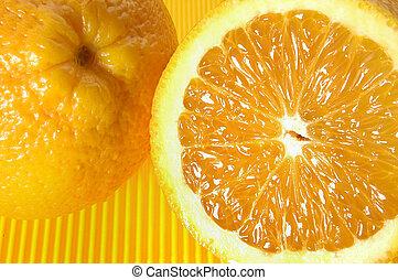 fresh orange on yellow background
