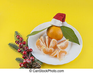 Fresh oranges bowl with green leaf on yellow background