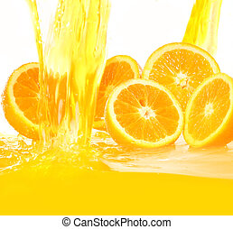 Fresh oranges falling in juice with lot of huge splashes