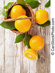 Fresh oranges - Fresh harvested oranges in basket