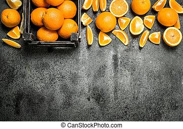 Fresh oranges in a box.