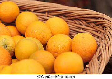 Fresh oranges in a fruit basket