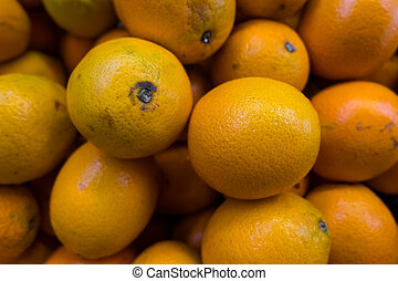 Fresh oranges in a market stall.