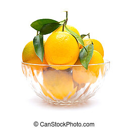 fresh oranges in glass bow on a white background