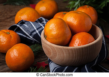 Fresh oranges in wooden bowl.
