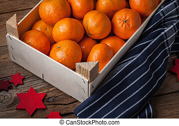 Fresh oranges in wooden box