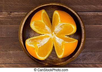 fresh oranges on a wooden background