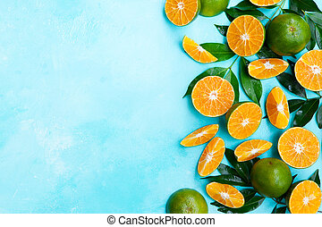 Fresh oranges on blue background. Top view. Copy space.