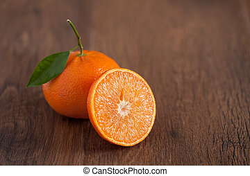 fresh oranges on the brown wooden table