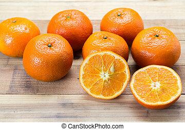 Fresh oranges on wooden background.
