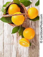 Fresh oranges - Fresh harvested oranges in basket